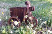 Triciclo con un cubo. (Plantador)