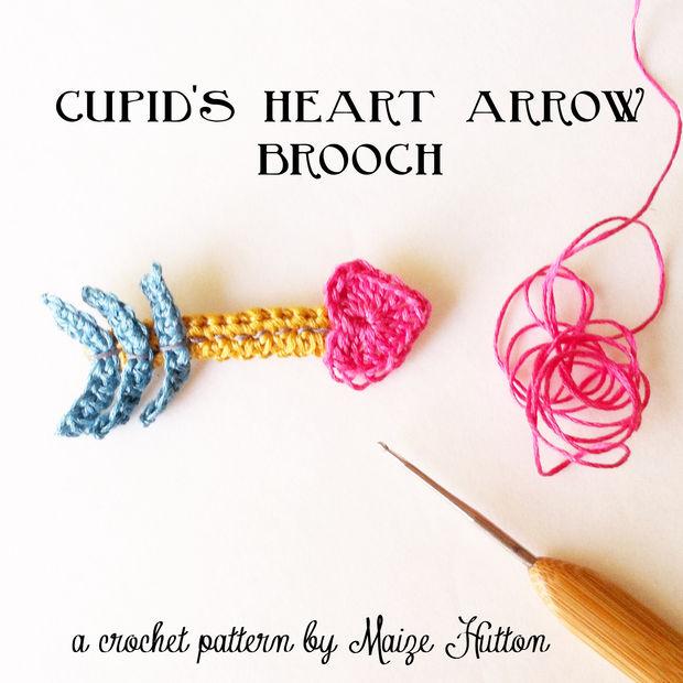Un corazón Cupido flecha broche de ganchillo - askix.com
